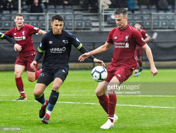 Liam Millar of Liverpool and Lee Buchanan of Derby County in action during the PL2 game at The Kirkby Academy on October 21 2018 in Kirkby England
