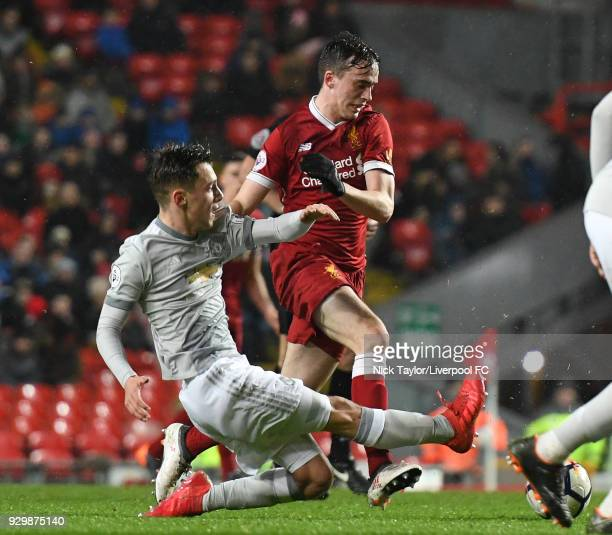 Liam Millar of Liverpool and Lee O'Conner of Manchester United in action during the Premier League 2 match between Liverpool and Manchester United at...