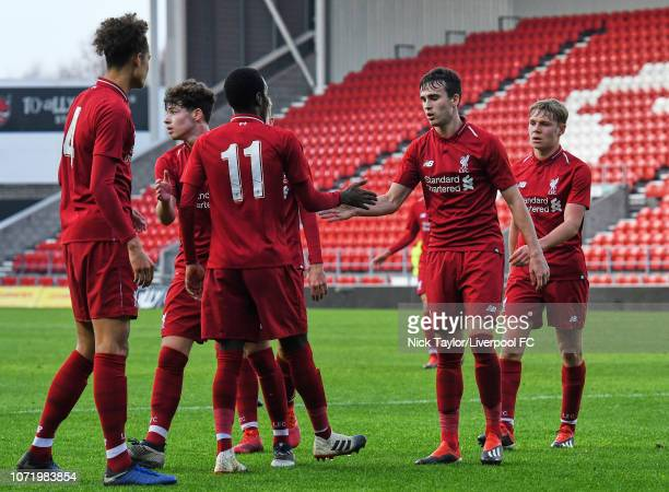Liam Millar of Liverpool celebrates his goal with Rafael Camacho during the UEFA Youth League match between Liverpool and SSC Napoli at Langtree Park...