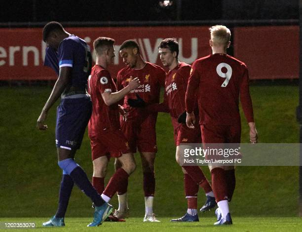 Liam Millar of Liverpool celebrates scoring the opening goal with team mates during the Premier League Cup game at the Academy on February 21 2020 in...