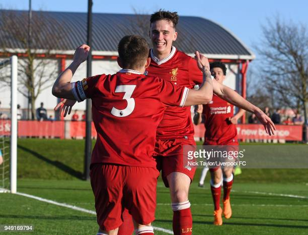Liam Millar of Liverpool celebrates scoring the opening goal with Adam Lewis during the Liverpool v Manchester United U18 Premier League game at The...