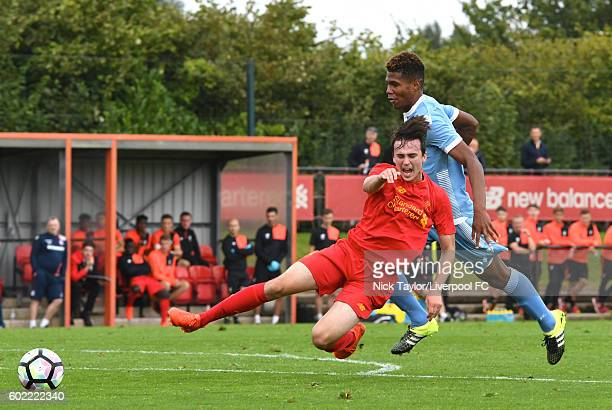 Liam Millar of Liverpool is brought down by Scot Wara of Stoke City in action during the U18 Premier League game between Liverpool and Stoke City at...
