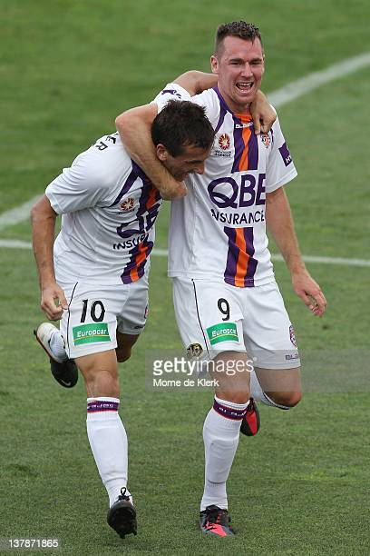 Liam Miller and Shane Smeltz celebrate after Miller scored a goal during the round 17 ALeague match between Adelaide United and Perth Glory at...