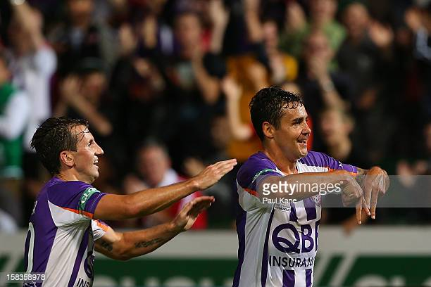 Liam Miller and Travis Dodd of the Glory celebrate a goal during the round 11 ALeague match between the Perth Glory and the Newcastle Jets at nib...