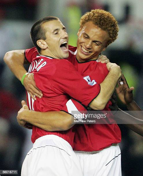Liam Miller of Manchester United celebrates scoring the first goal with team mate Wes Brown during the Carling Cup third round match between...
