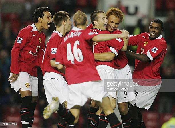 Liam Miller of Manchester United celebrates scoring the first goal during the Carling Cup third round match between Manchester United and Barnet at...