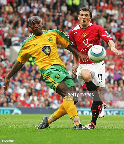 Liam Miller of Manchester United clashes with Damien Francis of Norwich City during the Barclays Premiership match between Manchester United and...