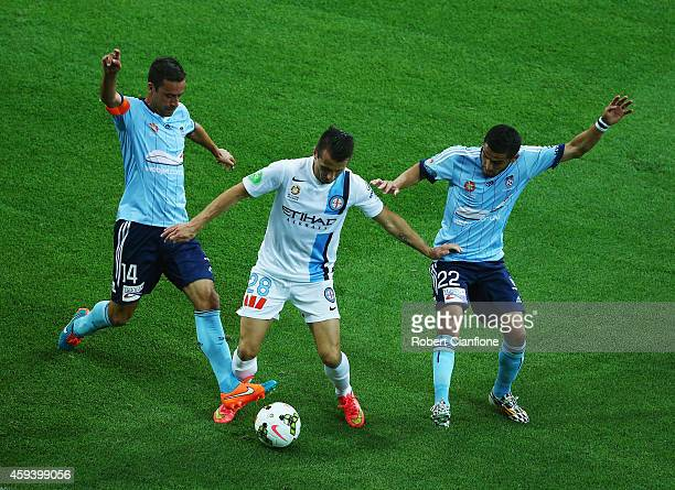 Liam Miller of Melbourne City is challenged by Alex Brosque and Ali Abbas of Sydney FC during the round seven ALeague match between Melbourne City...