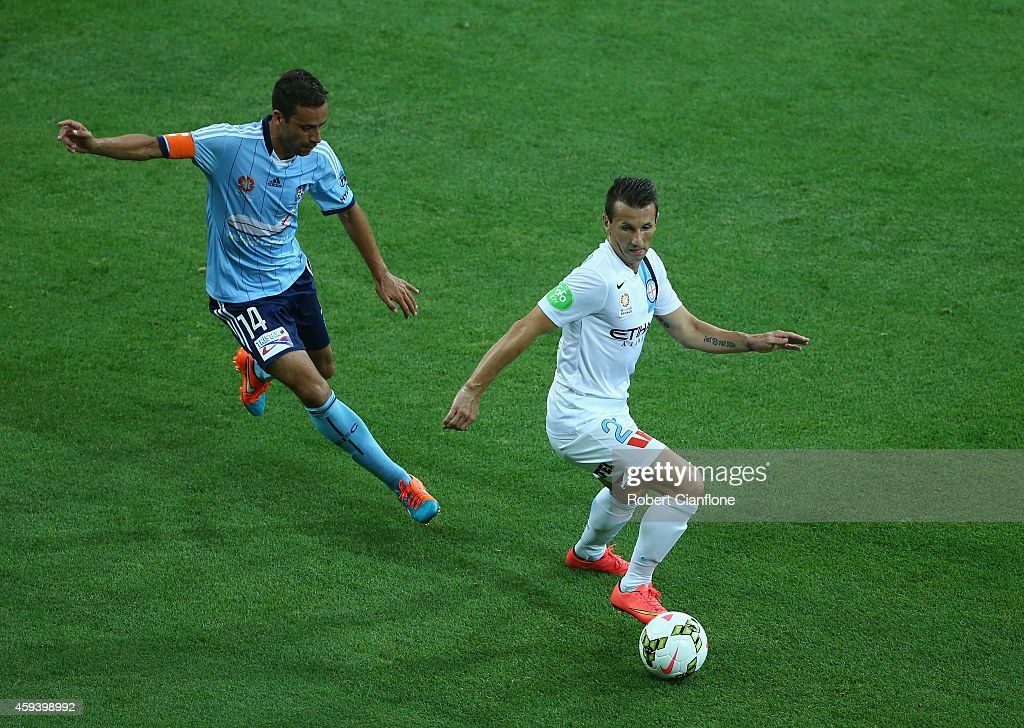 Liam Miller of Melbourne City is chased by Alex Brosque of Sydney FC during the round seven A-League match between Melbourne City and Sydney FC at AAMI Park on November 22, 2014 in Melbourne, Australia.