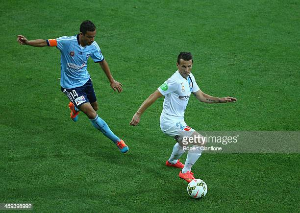 Liam Miller of Melbourne City is chased by Alex Brosque of Sydney FC during the round seven ALeague match between Melbourne City and Sydney FC at...