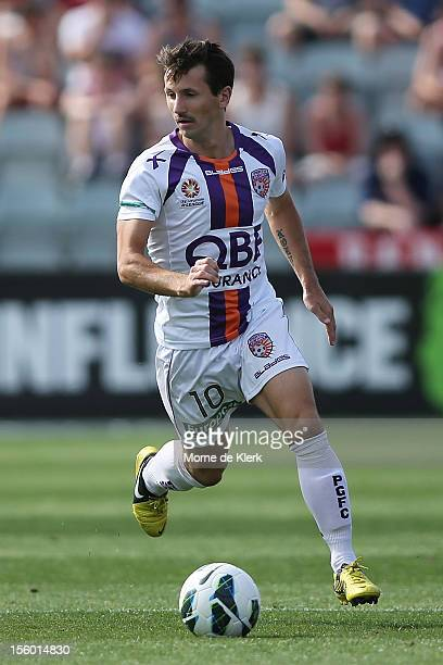 Liam Miller of Perth runs with the ball during the round six ALeague match between Adelaide United and the Perth Glory at Hindmarsh Stadium on...