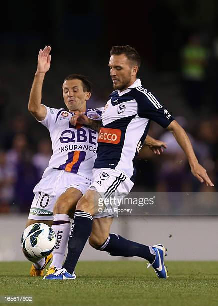 Liam Miller of the Glory and Billy Celeski of the Victory contest for the ball during the ALeague Elimination final match between Melbourne Victory...