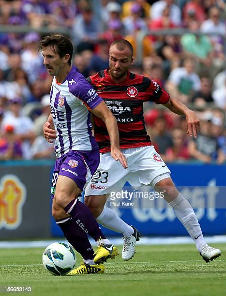 Liam Miller of the Glory and Jason Truifiro of the Wanderers contest for the ball during the round seven ALeague match between Perth Glory and the...