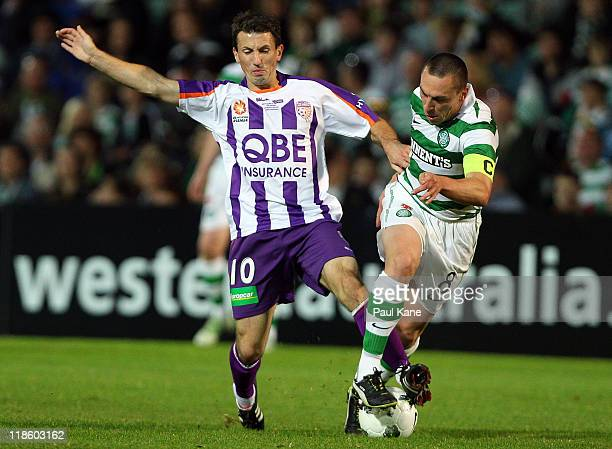 Liam Miller of the Glory and Scott Brown of Celtic contest the ball during the international friendly club match between the Perth Glory and Glasgow...