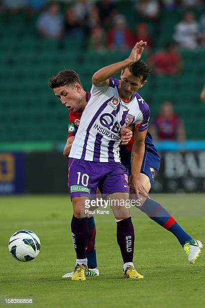 Liam Miller of the Glory and Scott Neville of the Jets contest for the ball during the round 11 ALeague match between the Perth Glory and the...