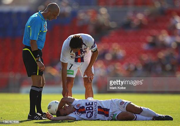 Liam Miller of the Glory holds his head as he lies on the ground during the round 13 ALeague match between the Newcastle Jets and the Perth Glory at...