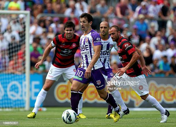 Liam Miller of the Glory looks to have a shot on goal during the round seven ALeague match between Perth Glory and the Western Sydney Wanderers at...