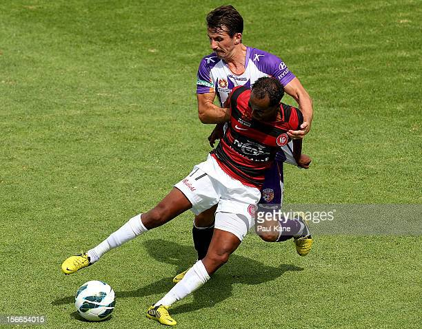 Liam Miller of the Glory tackles Youssouf Hersi of the Wanderers during the round seven ALeague match between Perth Glory and the Western Sydney...