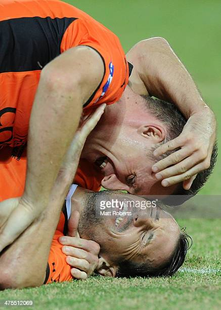 Liam Miller of the Roar celebrates a goal with Besart Berisha during the round 21 ALeague match between Brisbane Roar and Perth Glory at Suncorp...