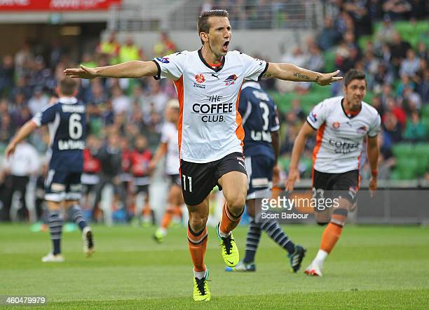 Liam Miller of the Roar celebrates after scoring the first goal of the game during the round 13 ALeague match between the Melbourne Victory and...