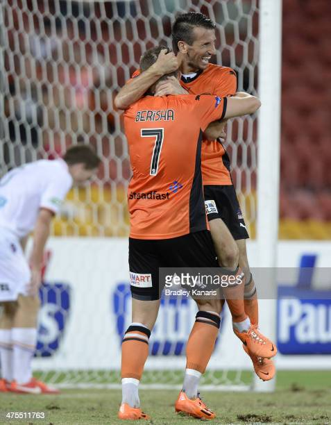 Liam Miller of the Roar celebrates with Besart Berisha after scoring a goal during the round 21 ALeague match between Brisbane Roar and Perth Glory...