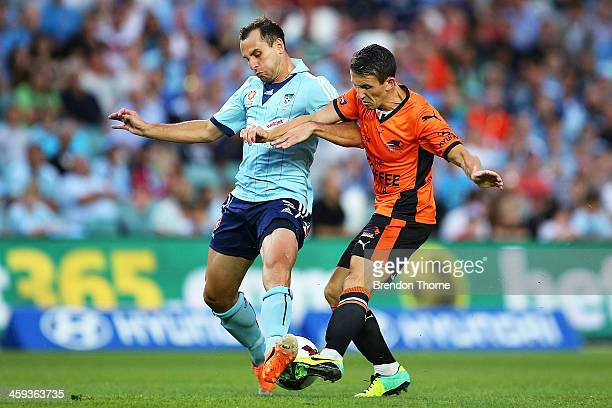 Liam Miller of the Roar competes with Richard Garcia of Sydney during the round 12 ALeague match between Sydney FC and Brisbane Roar at Allianz...