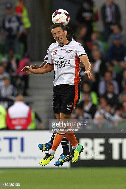 Liam Miller of the Roar heads the ball during the round 13 ALeague match between the Melbourne Victory and Brisbane Roar at AAMI Park on January 4...