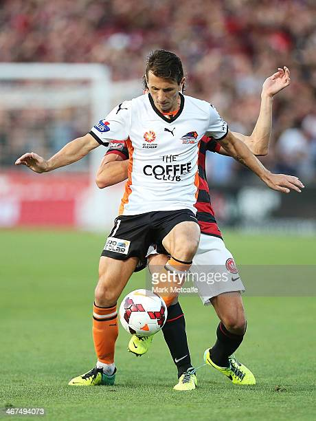 Liam Miller of the Roar is challenged by Mateo Poljak of the Wanderers during the round 18 ALeague match between the Western Sydney Wanderers and...