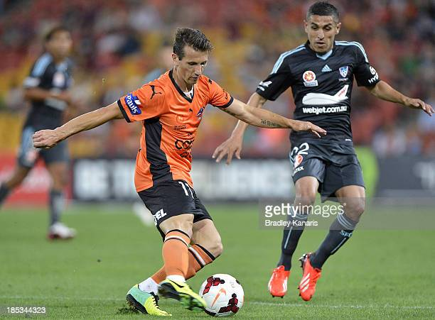 Liam Miller of the Roar kicks the ball during the round two ALeague match between Brisbane Roar and Sydney FC at Suncorp Stadium on October 19 2013...