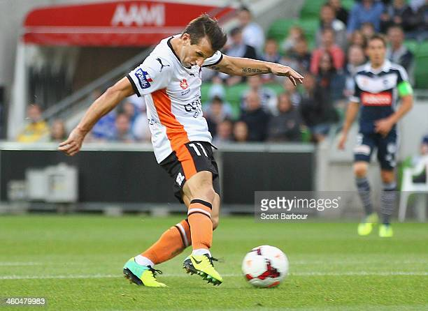 Liam Miller of the Roar shoots to score the first goal of the game during the round 13 ALeague match between the Melbourne Victory and Brisbane Roar...