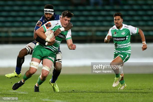 Liam Mitchell of Manawatu is tackled by Joketani Koroi of Otago during the round three Mitre 10 Cup match between Manawatu and Otago at Central...