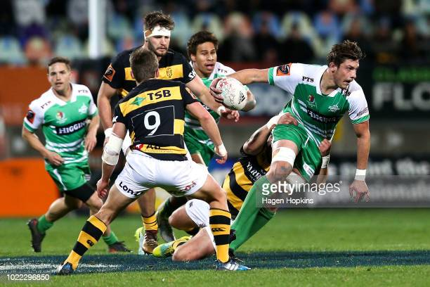 Liam Mitchell of Manawatu is tackled during the round two Mitre 10 Cup Ranfurly Shield match between Taranaki and Manawatu at Yarrow Stadium on...