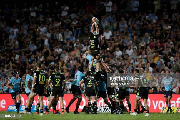 Liam Mitchell of the Hurricanes takes a line out during the round one Super Rugby match between the Waratahs and the Hurricanes at Brookvale Oval on...