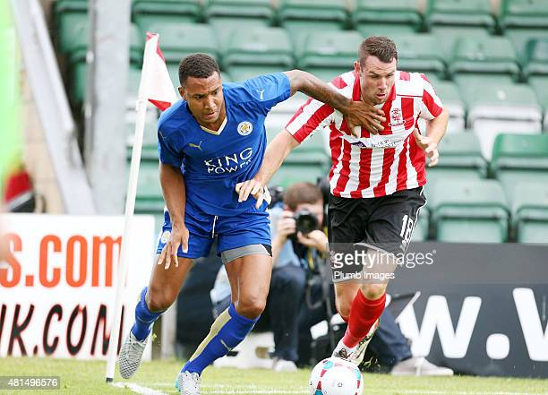 Liam Moore of Leicester city in action with Lee Beevers of Lincoln City during the preseason friendly between Lincoln City and Leicester City at...