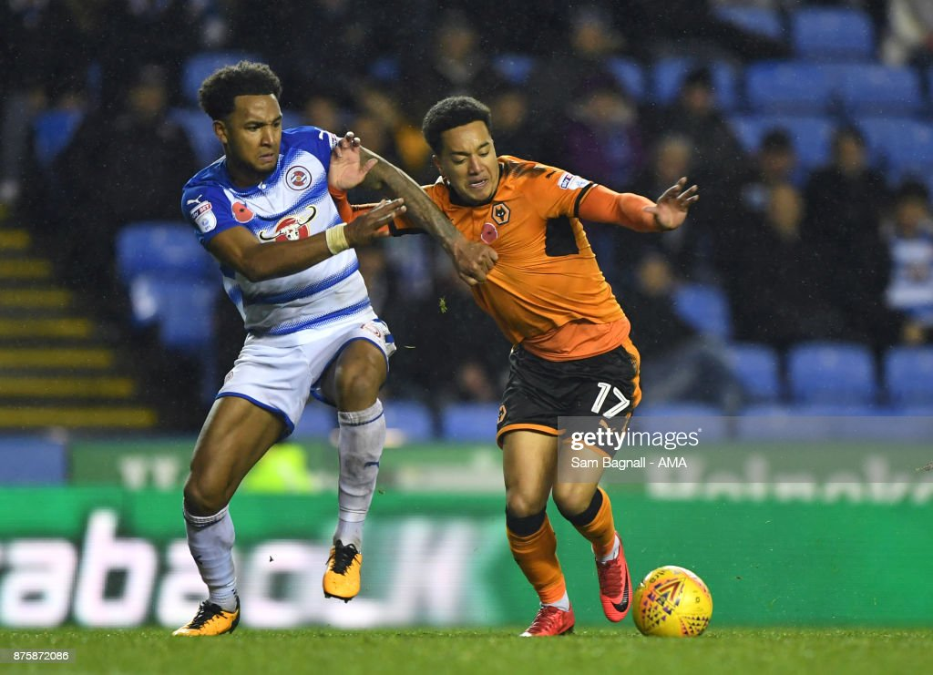 Liam Moore of Reading and Helder Costa of Wolverhampton Wanderers during the Sky Bet Championship match between Reading and Wolverhampton at Madejski Stadium on November 18, 2017 in Reading, England.