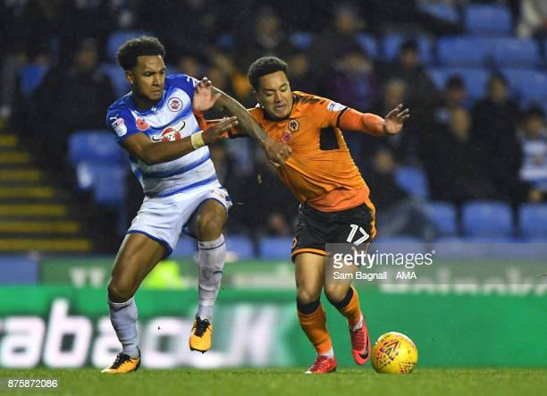 Liam Moore of Reading and Helder Costa of Wolverhampton Wanderers during the Sky Bet Championship match between Reading and Wolverhampton at Madejski...