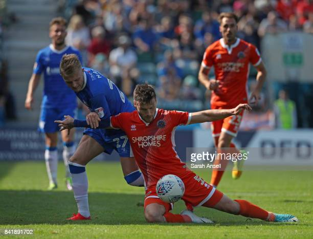 Liam Nash of Gillingham tussles with Mat Sadler of Shrewsbury Town during the Sky Bet League One match between Gillingham and Shrewsbury Town at...