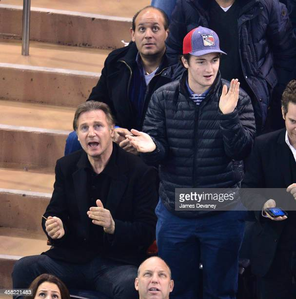 Liam Neeson and Daniel Neeson attend the Long Island Islanders vs New York Rangers game at Madison Square Garden on December 20 2013 in New York City