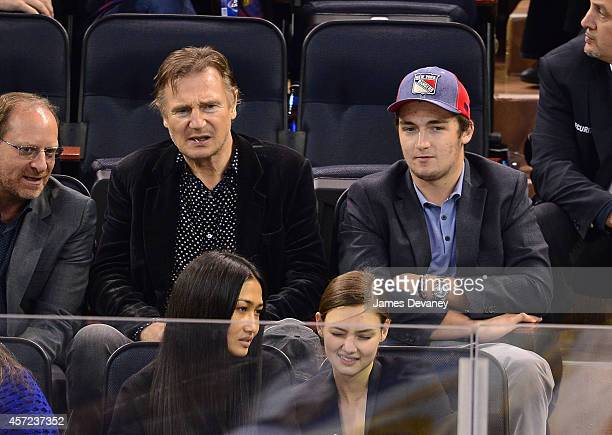 Liam Neeson and Daniel Neeson attend the New York Islanders vs New York Rangers game at Madison Square Garden on October 14 2014 in New York City