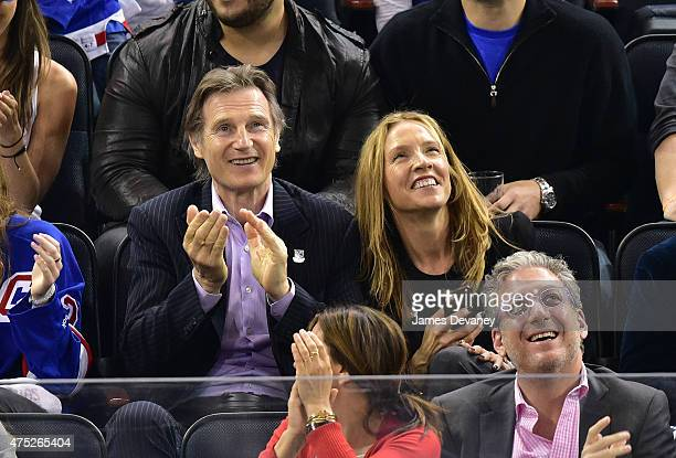 Liam Neeson and Freya St Johnston attend the Tampa Bay Lightning vs New York Rangers playoff game at Madison Square Garden on May 29 2015 in New York...