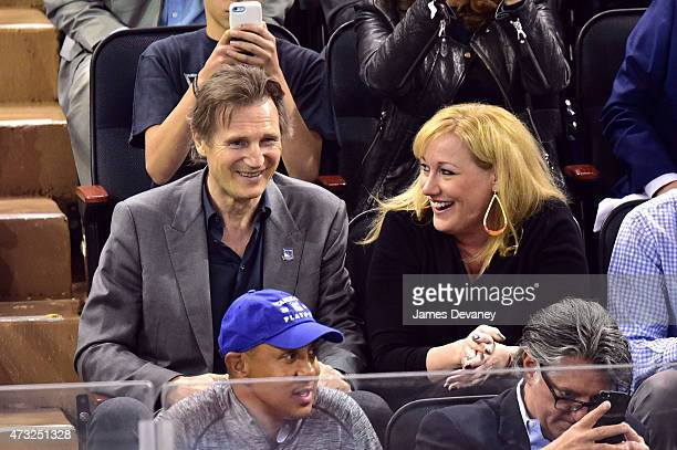 Liam Neeson and guest attend the Washington Capitals vs New York Rangers game at Madison Square Garden on May 13 2015 in New York City
