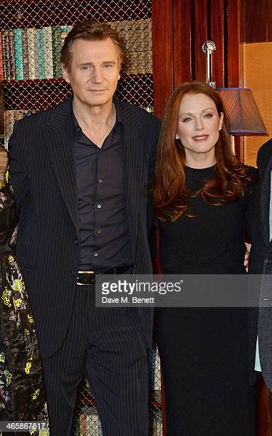 Liam Neeson and Julianne Moore attend a photocall for 'NonStop' at China Tang at The Dorchester on January 30 2014 in London England