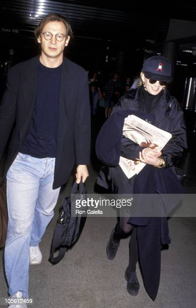Liam Neeson and Natasha Richardson during Liam Neeson Departing for New York City at Los Angeles International Airport in Los Angeles California...