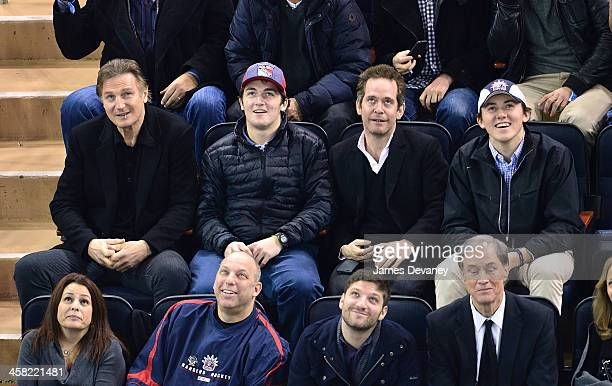 Liam Neeson Daniel Neeson and guests attend the Long Island Islanders vs New York Rangers game at Madison Square Garden on December 20 2013 in New...