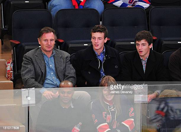 Liam Neeson Michael Neeson and Daniel Neeson attend the San Jose Sharks vs the New York Rangers game at Madison Square Garden on October 31 2011 in...