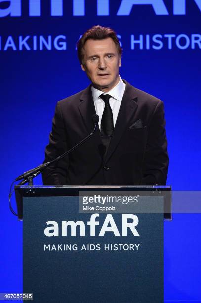 Liam Neeson speaks onstage during the 2014 amfAR New York Gala at Cipriani Wall Street on February 5, 2014 in New York City.