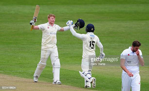 Liam Norwell of Gloucestershire celebrates with Chris Dent of Gloucestershire after reaching his maiden century as Ben Cotton of Derbyshire reacts...