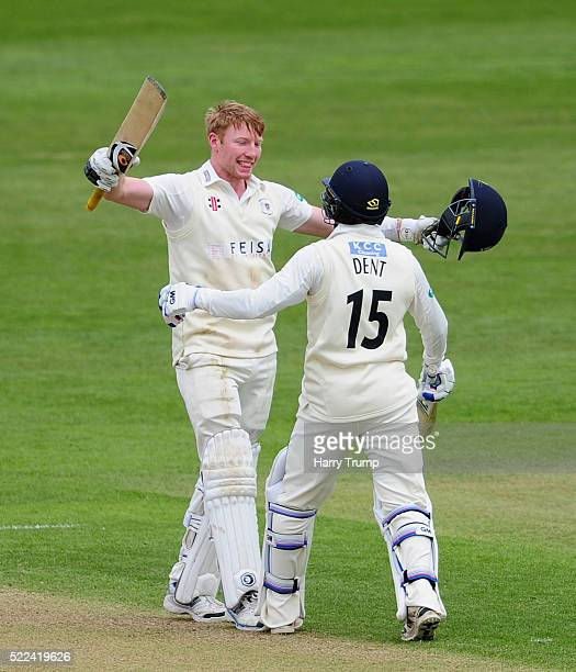 Liam Norwell of Gloucestershire celebrates with Chris Dent of Gloucestershire after reaching his maiden century during Day Three of the Specsavers...