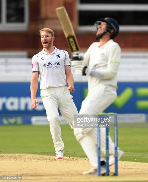 Liam Norwell of Warwickshire reacts after Tom Bailey of Lancashire hits the ball in the air and is caught by Michael Burgess of Warwickshire during...