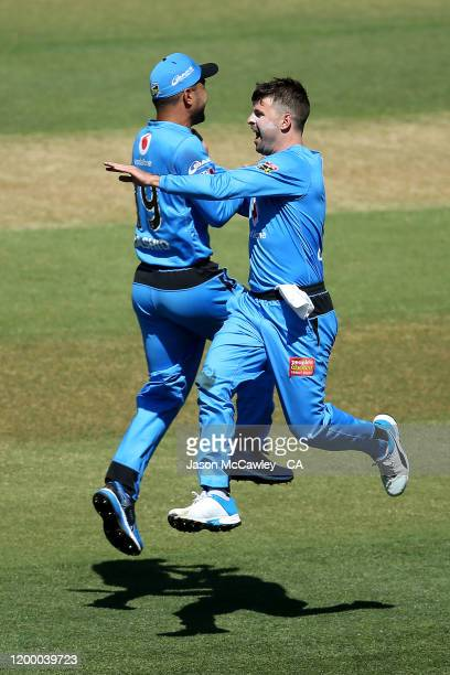 Liam O'Connor of the Strikers celebrates taking a wicket during the Big Bash League match between the Adelaide Strikers and the Brisbane Heat at the...